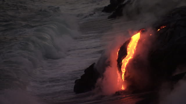 molten lava flows from erupting volcano, big island, hawaii - erupting stock videos & royalty-free footage