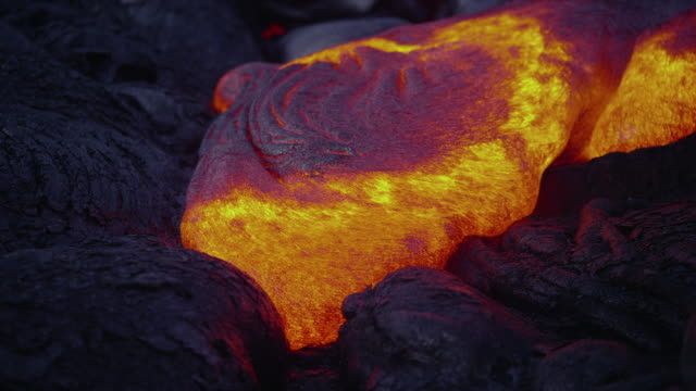 Molten lava oozes over cooling lava on the Pu'u O'o Crater.