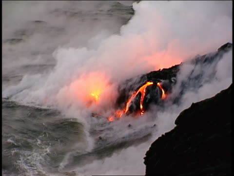 pan, ms molten lava pouring into ocean - lava stock-videos und b-roll-filmmaterial
