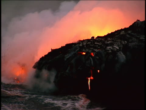 zo, ms molten lava pouring into ocean - lava stock-videos und b-roll-filmmaterial