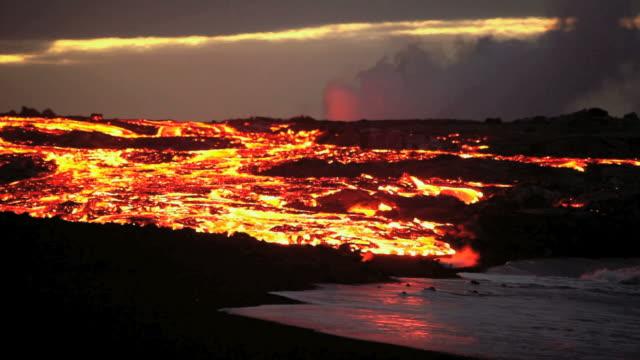 WS T/L Molten lava river falling into ocean at dawn / Kalapana, Hawaii, USA