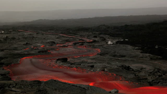 WS Molten lava river flowing through landscape / Kalapana, Hawaii, USA