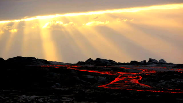 ws molten lava river flowing through slope at sunrise / kalapana, hawaii, usa - pacific islands stock videos & royalty-free footage