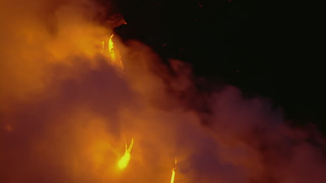 Molten lava with large cloud of steam in Hawaii Volcanoes National Park.
