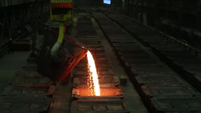 Molten liquid copper is poured into moulds from the furnace at the MMC Norilsk Nickel PJSC copper refinery in Norilsk Russia on Thursday Oct 19...