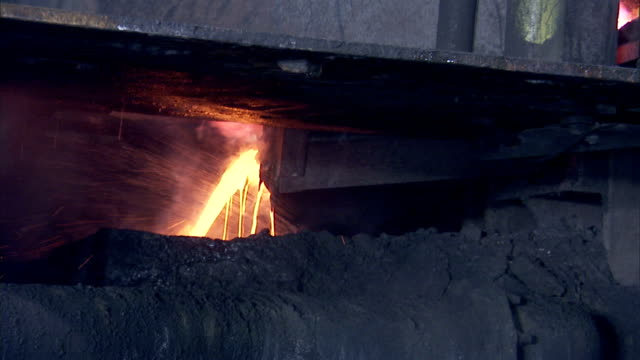 molten metal flows from a steel mill blast furnace. - blast furnace stock videos & royalty-free footage
