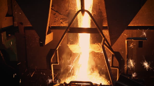 molten metal melting, operator tapping molten metal from furnace to ladle for pouring to in factory - power equipment stock videos & royalty-free footage
