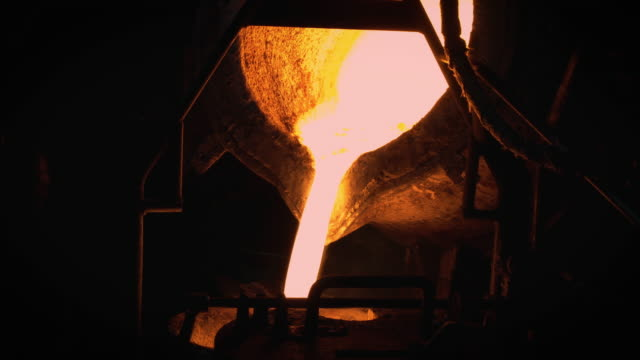 molten metal melting, operator work hard tapping molten metal from furnace to ladle for pouring to in foundry factory - power equipment stock videos & royalty-free footage