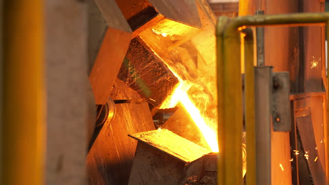 molten metal melting, operator work hard tapping molten metal from furnace to ladle for pouring to in foundry factory - efficiency stock videos & royalty-free footage