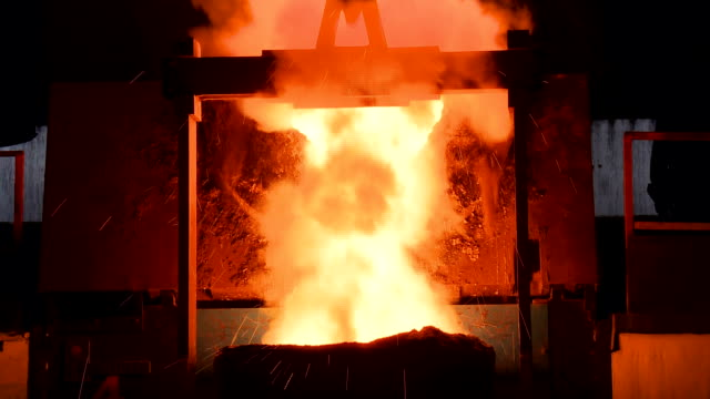 molten metal pouring out of furnace. liquid metal from blast furnace. - casting stock videos & royalty-free footage