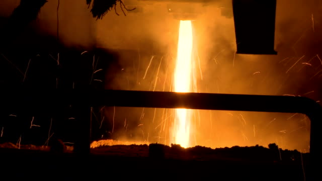 molten metal pouring out of furnace. liquid metal from blast furnace. - foundry stock videos & royalty-free footage