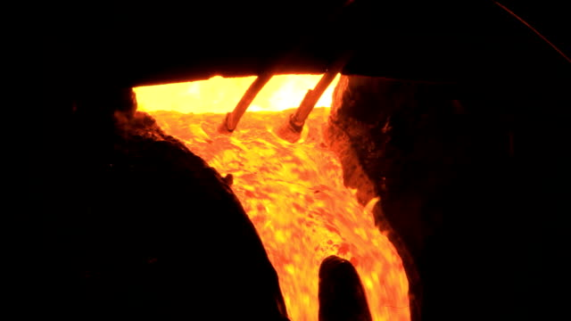 Molten metal starts to flow from the furnace