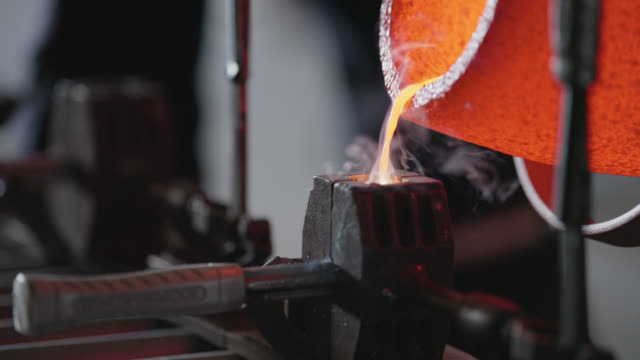 cu molten steel being poured into hammer mold - handle stock videos & royalty-free footage