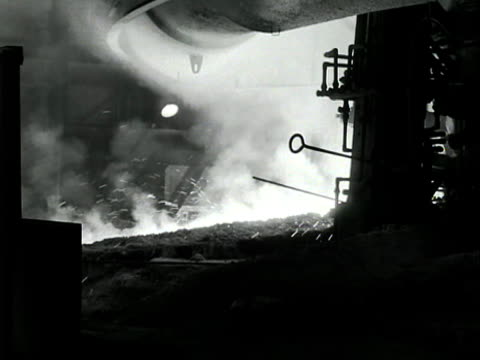 molten steel flows from a blast furnace at the scunthorpe steel works - blast furnace stock videos & royalty-free footage