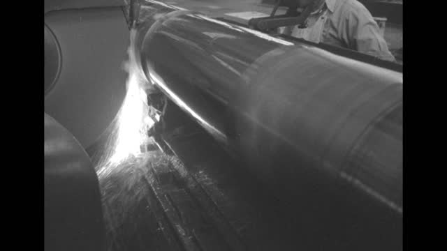 molten steel pouring over gun barrel, worker's shoulder in bg / note: exact day not known - gun barrel stock videos & royalty-free footage