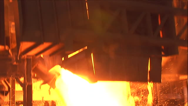 molten steel pours into a cauldron. - power equipment stock videos & royalty-free footage