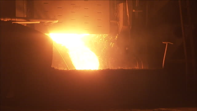 molten steel pours out of a furnace in a factory. - foundry stock videos & royalty-free footage