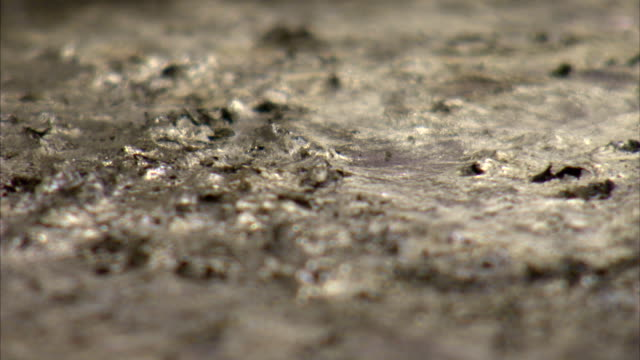 molten zinc for speltering simmers and bubbles. - metal stock videos & royalty-free footage