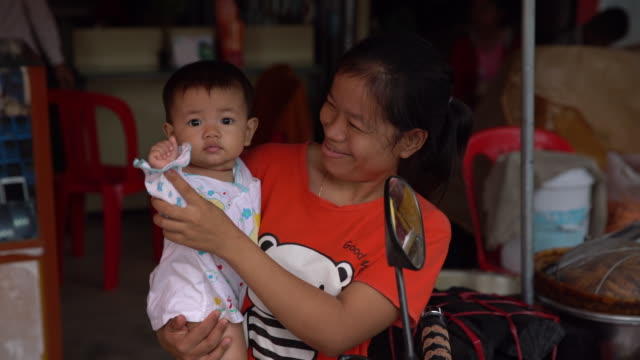 mom and baby smiling - cambodia stock videos and b-roll footage