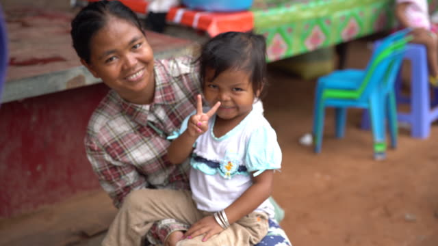 mom and child smiling - cambodia stock videos and b-roll footage