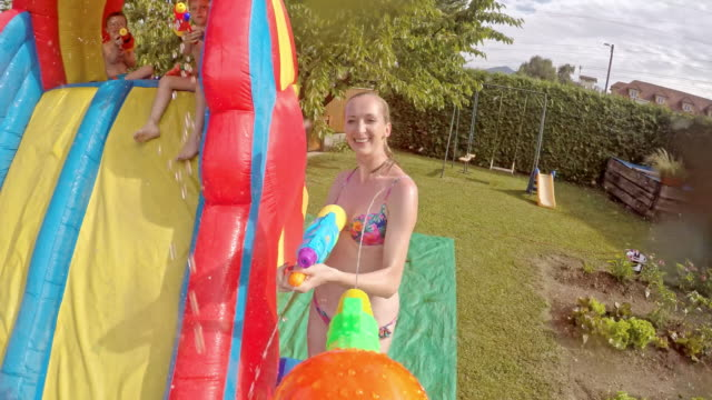 pov mom and dad in a water gun fight - squirt gun stock videos and b-roll footage
