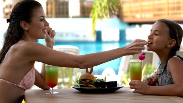 mom and daughter eating hamburger - tourist resort stock videos and b-roll footage
