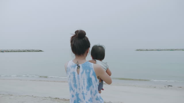 mom and her son relaxing on the beach - 6 11 months stock videos & royalty-free footage