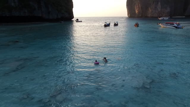 mom and kid playing water in the bay - phi phi islands stock videos & royalty-free footage