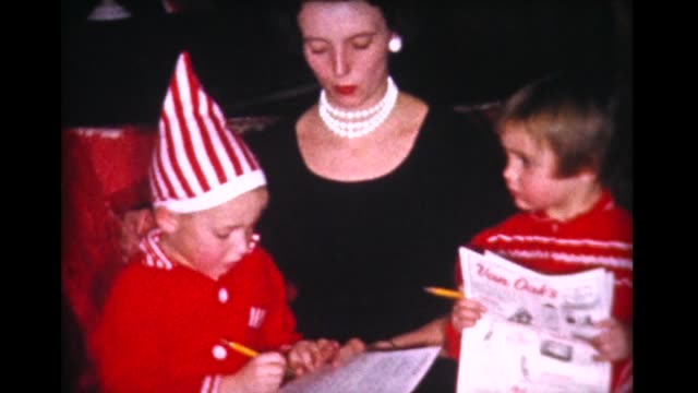 1960 mom and kids write Xmas list, set out cookies for Santa