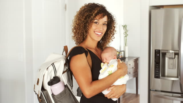 mom and newborn baby in a home - nappy bag stock videos & royalty-free footage