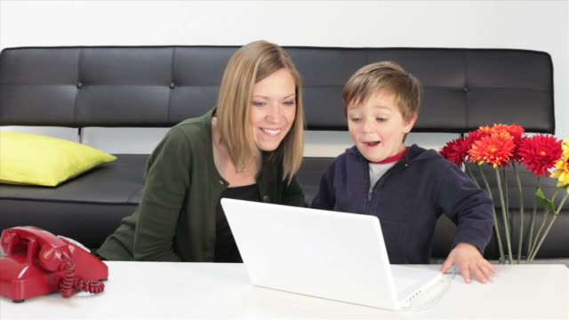 Mom and toddler on laptop