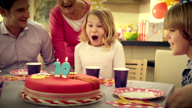 slo mo mom bringing the birthday cake - carrying stock videos & royalty-free footage