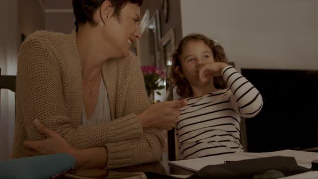 vídeos de stock, filmes e b-roll de mamãe se importa muito com o futuro de seu pequeno. - exclusivo
