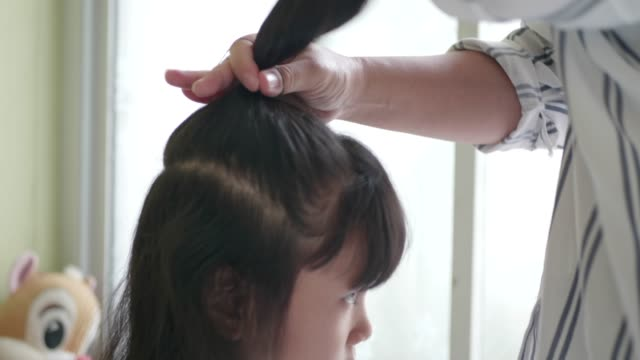 mom combing her little girl. - hairbrush stock videos & royalty-free footage