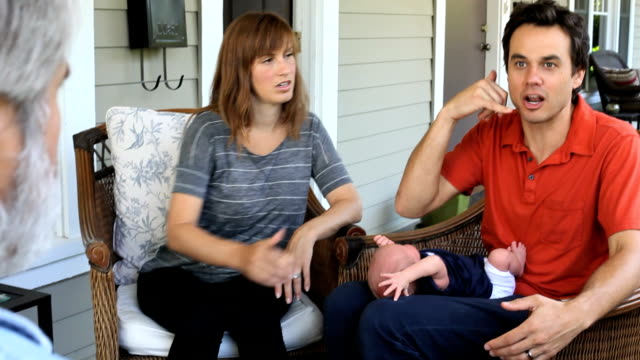 mom dad, baby and grandfather on porch - unknown gender stock videos & royalty-free footage