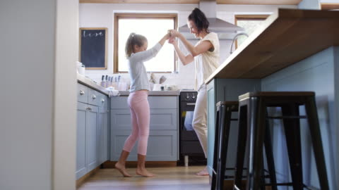 mom has a few moves to show - kitchen stock videos & royalty-free footage