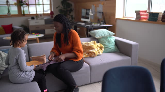 mom helping her daughter to get ready for school - rucksack stock videos & royalty-free footage