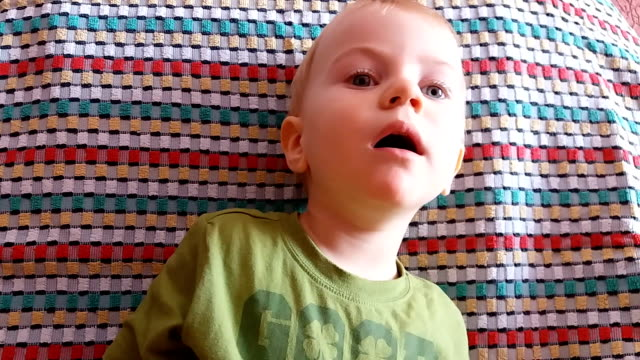 mom interferes her baby with watching cartoons - peeking stock videos and b-roll footage