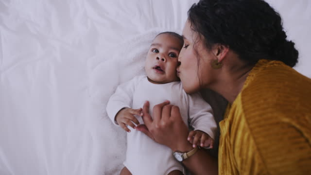 mom is always there to make everything better - kissing stock videos & royalty-free footage