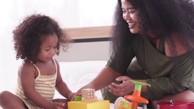 mom play toy with kids - young family stock videos & royalty-free footage