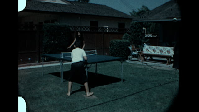 mom playing ping pong - home movie stock videos & royalty-free footage