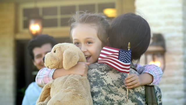 mom returns home from overseas military assignment - american flag stock videos and b-roll footage