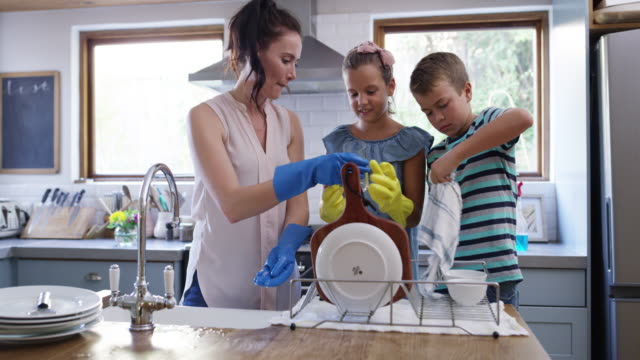 mom shouldn't be doing dishes alone! - washing up stock videos & royalty-free footage