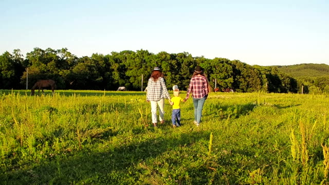 mom, son and daughter walking - ranch family stock videos & royalty-free footage