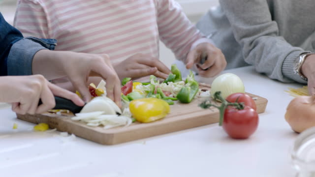 mom teaching daughter to cook a meal - onion stock videos & royalty-free footage