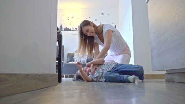mom tickles her little son - 2 3 years stock videos & royalty-free footage