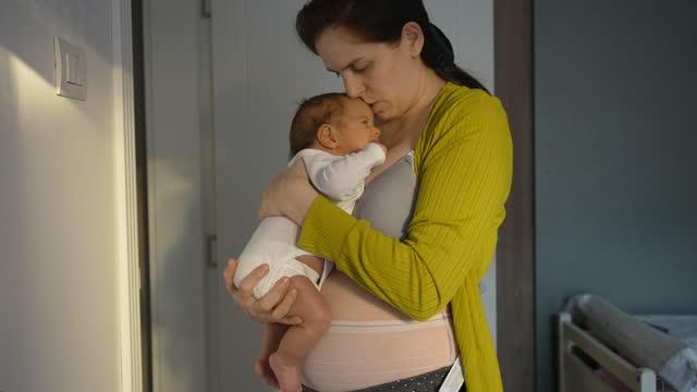 mom wearing postpartum underwear holding newborn baby girl - single mother stock videos & royalty-free footage