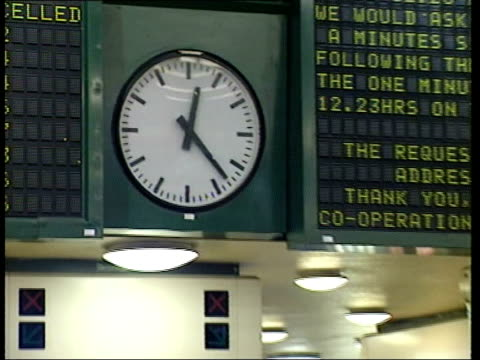 moment of silence for the hatfield disaster yorkshire leeds station gvs clock as moves to 1223 minute's silence begins pull out to station staff... - hatfield stock videos and b-roll footage