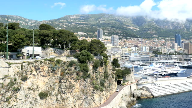 monaco aerial monte carlo city building waterfront marina - monaco stock videos and b-roll footage