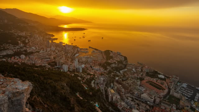 stockvideo's en b-roll-footage met motion t/l monaco city bij sunrise - schemering